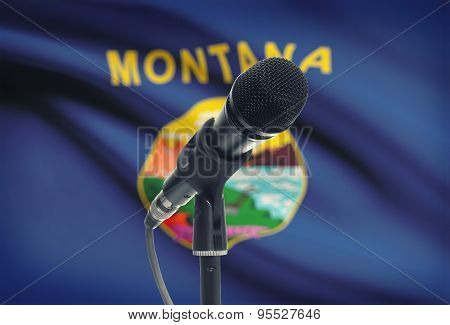 Microphone On Stand With Us State Flag On Background - Montana