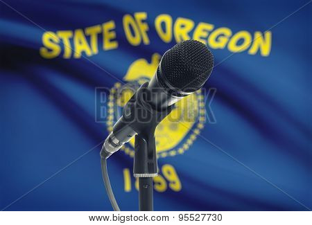 Microphone On Stand With Us State Flag On Background - Oregon