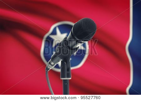 Microphone On Stand With Us State Flag On Background - Tennessee