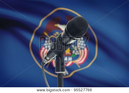 Microphone On Stand With Us State Flag On Background - Utah