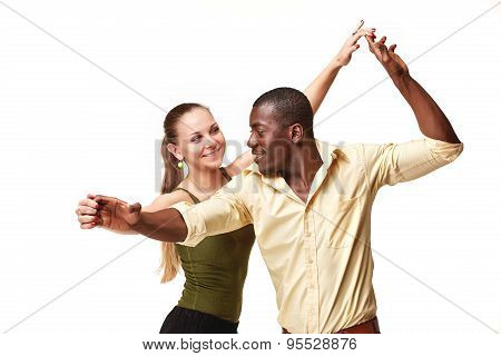 Young couple dances Caribbean Salsa, studio shot