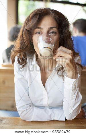 Drinking Cappuccino Coffee Looking At Camera
