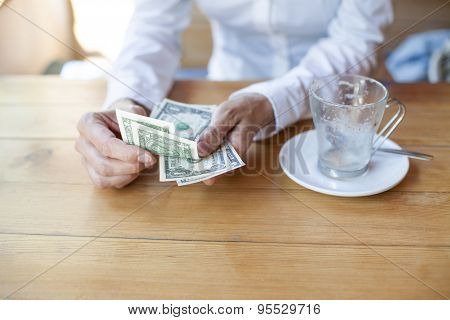 Ready To Pay Coffee With Dollar Banknotes