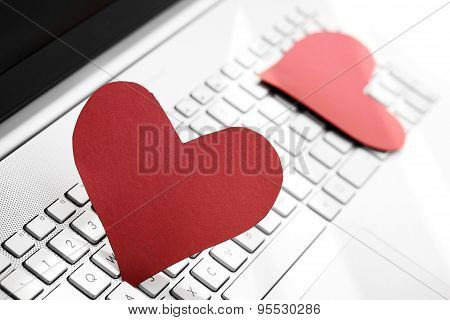 Internet Dating Concept - Two Paper Hearts On Computer Keyboard