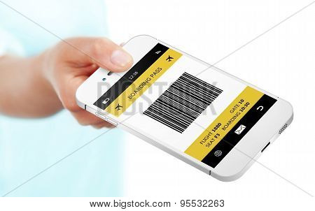 Hand Holding Mobile Phone With Boarding Pass Isolated Over White