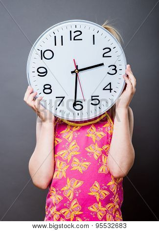 Picture of beautiful girl with big clock