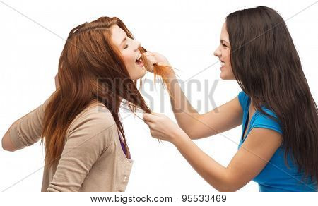 bullying, friendship and people concept - two teenagers having a fight and getting physical
