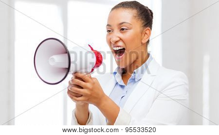 business and communication, bad boss concept - strict businesswoman shouting in megaphone in office
