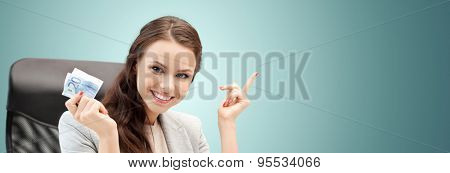 finances, people, savings and investment concept - happy business woman with euro cash money over blue background