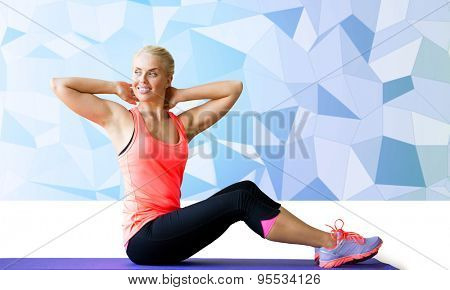 fitness, sport, exercising and people concept - smiling woman doing sit-up on mat over blue low poly background