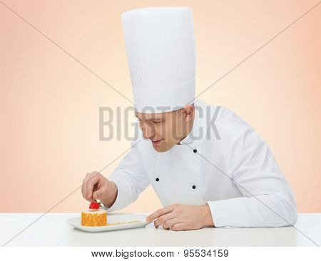 cooking, profession, haute cuisine, food and people concept - happy male chef cook decorating dessert over beige background