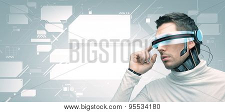 people, technology, future and progress - man with futuristic 3d glasses and microchip implant or sensors over gray background and blank virtual screens