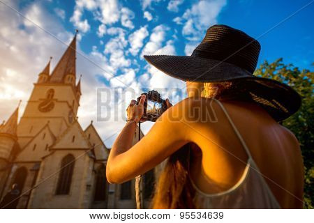 Tourist photographing ghotic cathedral in Romania