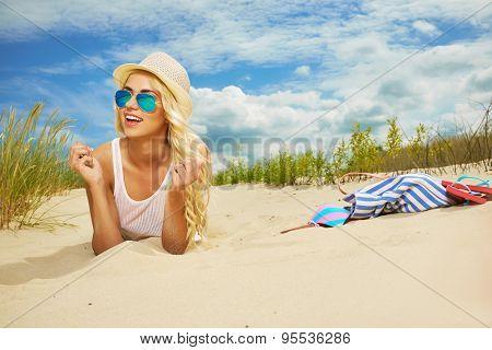 long blonde haired girl in bikini on  beach