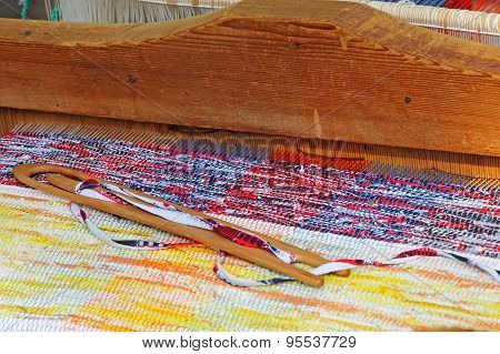 Multicolored Rug On A Weaving Loom.