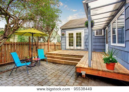 Perfect Back Deck With Concrete Patio And Chairs.
