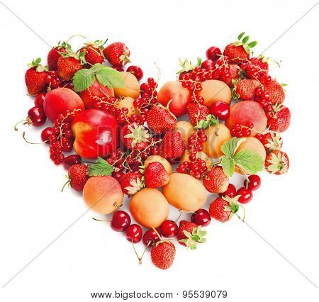 Summer berries in heart shape isolated on white