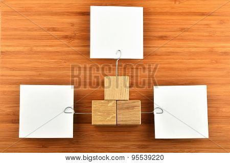Three Paper Notes With Holders In Different Directions On Wood