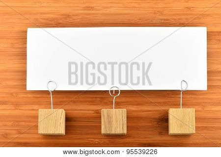 One Paper Note With Three Holders Isolated On Wooden Background