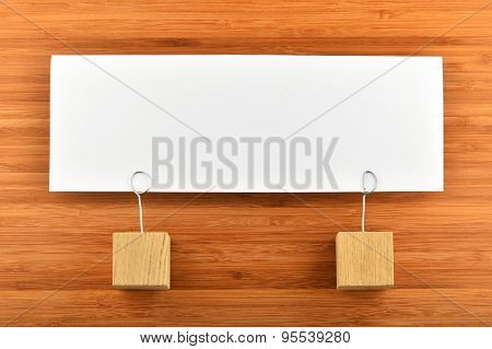 One Paper Note With Two Holders Isolated On Wooden Background