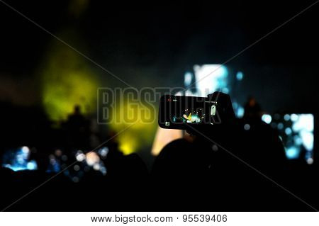 Crowd Of People Taking Photos With Smartphones At A Concert