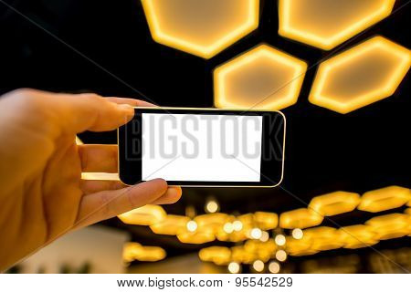 Holding phone on the modern light background