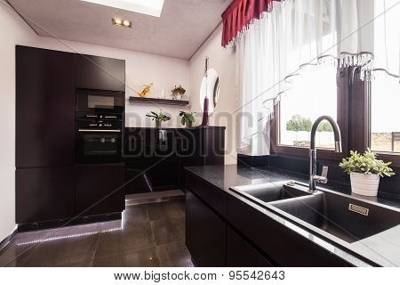 Brown Cupboards In Luxury Kitchen