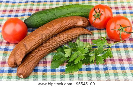 Smoked Sausage, Tomatoes, Cucumbers And Parsley On Tablecloth