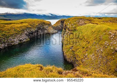 Iceland in July. The picturesque coastal bay near the fishing village of Arnastapi