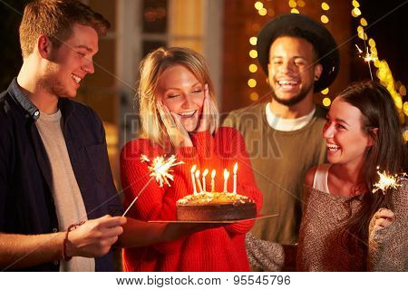 Group Of Friends Celebrating Birthday At Outdoor Party