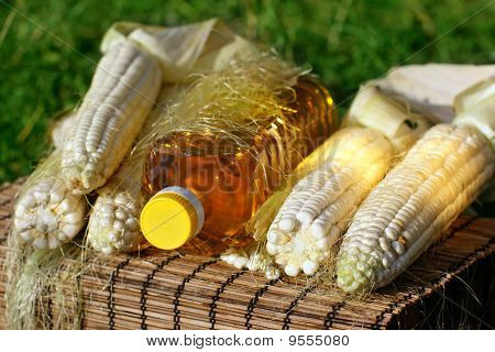 Bottle of oil and corn