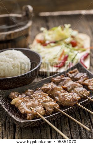 Roasted Pork With White Sticky Rice On Wooden Table