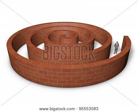 Person Inside A Maze Made Of Bricks.