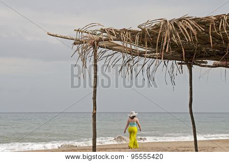 Woman Walking On Ocean Shore