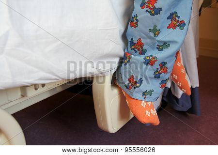 Child's Feet On Hospital Bed