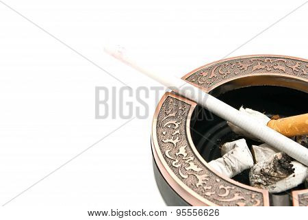 Ladies Cigarette In Metal Ashtray With Butts