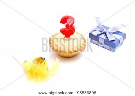 Cupcake With Three Years Birthday Candle, Gift And Whistle On White