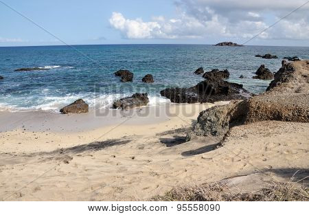 Ocean Rocks On White Sand Beach