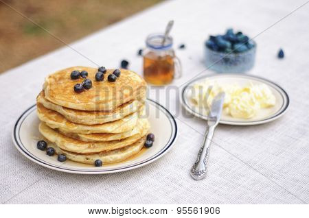 Pancakes with blueberries on the table