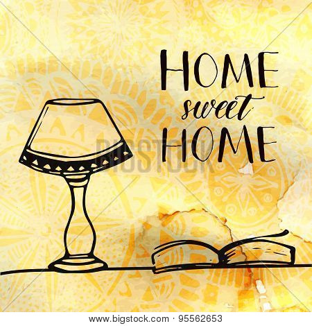 Lamp and book on the table and calligraphy text Home sweet home. Hand drawn doodles at coffee textur