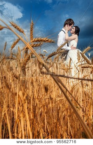 In Love Couple On Wedding Day At Wheat Field
