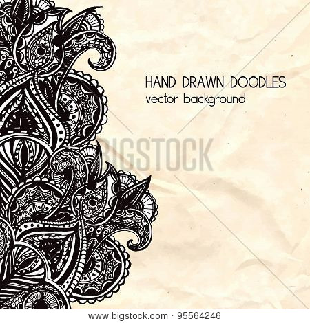 ornate black doodle element with paisleys on rumpled paper. vector layout design