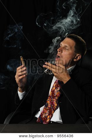 The Man With A Cigar And A Glass Of Cognac