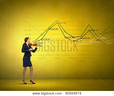 Young businesswoman playing violin and financial graphs at background