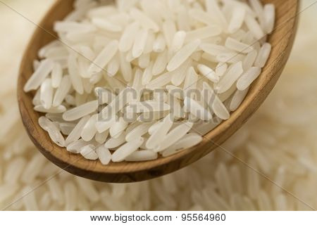 Long Grain Rice In A Wooden Spoon On A Background Plates . Healthy Eating, Diet, Vegetarianism.