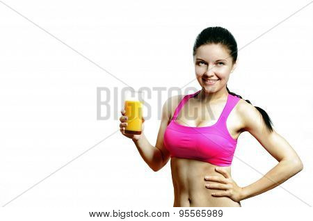 Young fit woman with a glass of an orange juice
