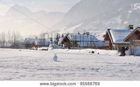 Chalets Under Snow
