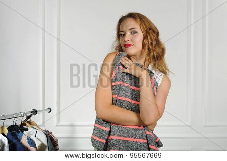 Woman Chooses Clothes In A Clothing Store
