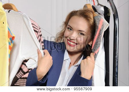 Woman Chooses Clothes In Clothes Shop