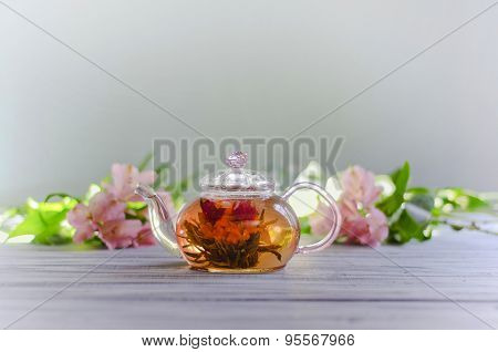 Flower green organic tea in a glass pot